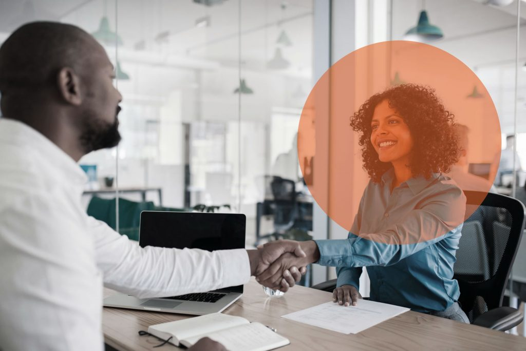Workday Optimisation consultant shakes hands with client with Preos orange dot overlayed