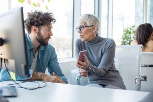 Woman and Man discuss Workday Release Management